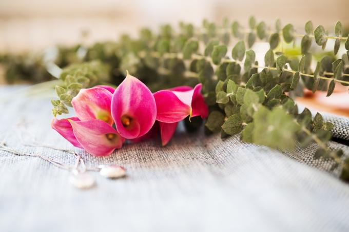 two lockets near flowers