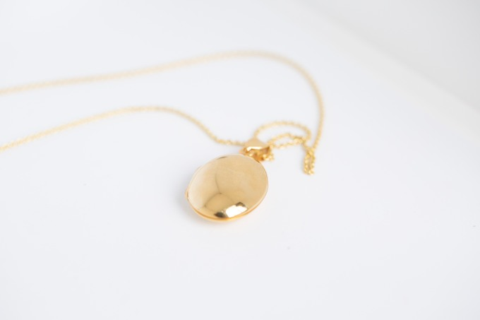 oval gold locket with photo inside
